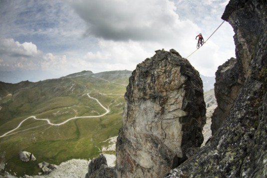 """kenny Belaey crossing """"Roche Fendue"""" on a high line at 100 meters above the ground."""