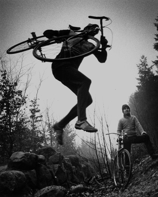 Cycle-cross, is only for the tough guys. Leif Jørgensen from Kalundborg can be seen one Sunday in January 1971 struggling with the wheel as he jumps in mud sleet and wind, © TopFoto / Archivi Alinari